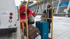 International air travellers arrive at one of the quarantine hotels Monday, February 22, 2021 in Montreal. Beginning today all travellers arriving from abroad will have a mandatory three day quarantine in a designated hotel. THE CANADIAN PRESS/Ryan Remiorz