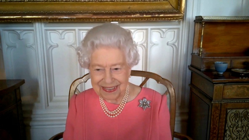 Queen Elizabeth smiles on a video call with the four health officials leading the deployment of the COVID-19 vaccination in England, Scotland, Wales and Northern Ireland, on Feb. 25, 2021. (Buckingham Palace via AP)