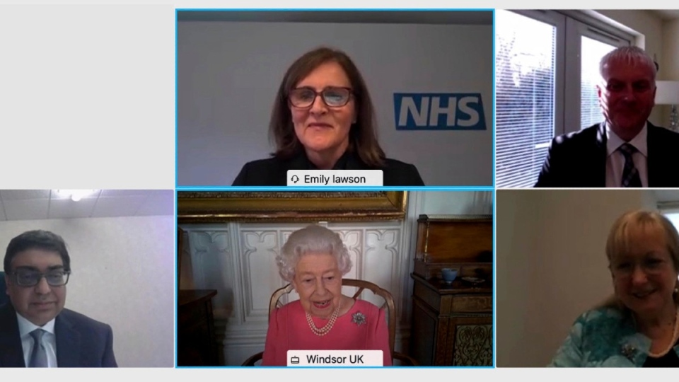 Queen Elizabeth smiles on the video call