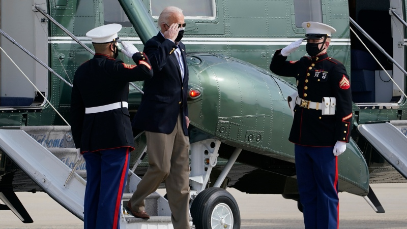 President Joe Biden walks off of Marine One to head towards Air Force One at Andrews Air Force Base, Md., Friday, Feb. 26, 2021. Biden will exercise his empathy skills during a Texas visit with a dual mission: surveying damage caused by severe winter weather and encouraging people to get their coronavirus shots. Biden and his wife, Jill, are traveling to Houston for the president's first trip to a major disaster site since he took office a little over a month ago. (AP Photo/Susan Walsh)