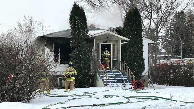 Edmonton fire crews worked to extinguish a blaze at a house just north of downtown, after a reported explosion. (Evan Klippenstein/CTV News Edmonton)