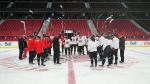 Brian Fraser's beloved Ottawa Senators started practice Friday morning by raising their sticks in his memory.