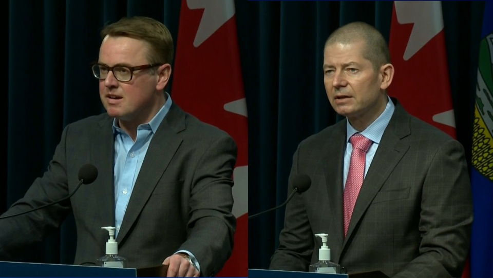 Health Minister Tyler Shandro and Dr. Paul Boucher, president of the AMA, at Friday's announcement of a tentative agreement between the province and its doctors.