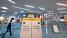 Signage for a new COVID-19 screening centre is pictured at Vancouver International Airport in Richmond, B.C. Friday, February 19, 2021. THE CANADIAN PRESS/Jonathan Hayward