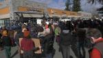 Demonstrators gather at B.C. Premier John Horgan's office in Langford on Feb. 26. (CTV News)