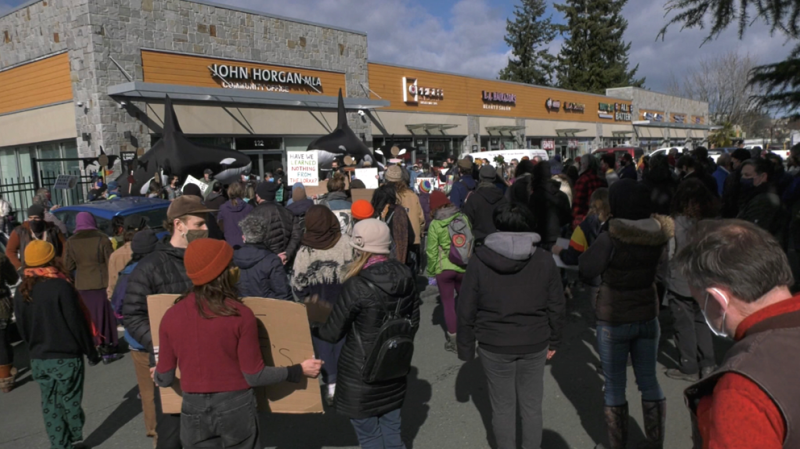 Demonstrators gather at B.C. Premier John Horgan's office in Langford on Feb. 26. (CTV News)