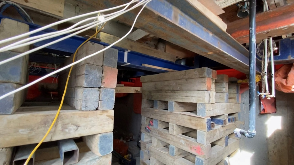 The Gilmore Street home was prepped by cutting holes in the old foundation and sliding massive steel beam under the house. Pneumatic pumps were used to jack the house up slowly. (Tyler Fleming/CTV News Ottawa)