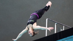 Lysanne Richard warms up prior to establishing a world indoor mixed double synchro 20-metre same platform diving record at the Olympic Pool in Montreal, Sunday, February 21, 2021. THE CANADIAN PRESS/Graham Hughes
