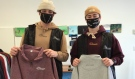 Kobe Seguin left, and Adam Kennedy say giving back to the community was top of mind when they started their new clothing line, Bay Apparel. (Alana Pickrell/CTV News)
