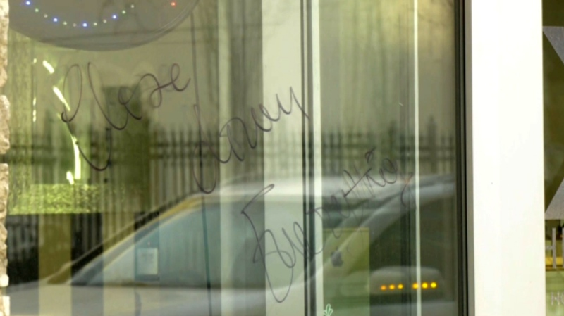 Businesses in downtown Edmonton were vandalized with messages asking them to stay closed.