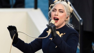 In this Wednesday, Jan. 20, 2021 file photo, Lady Gaga sings the national anthem during President-elect Joe Biden's inauguration at the U.S. Capitol in Washington. Lady Gaga's two French bulldogs, which were stolen by thieves who shot and wounded the dogwalker, were recovered unharmed Friday, Feb. 26, 2021 Los Angeles police said.(AP Photo/Saul Loeb, Pool)