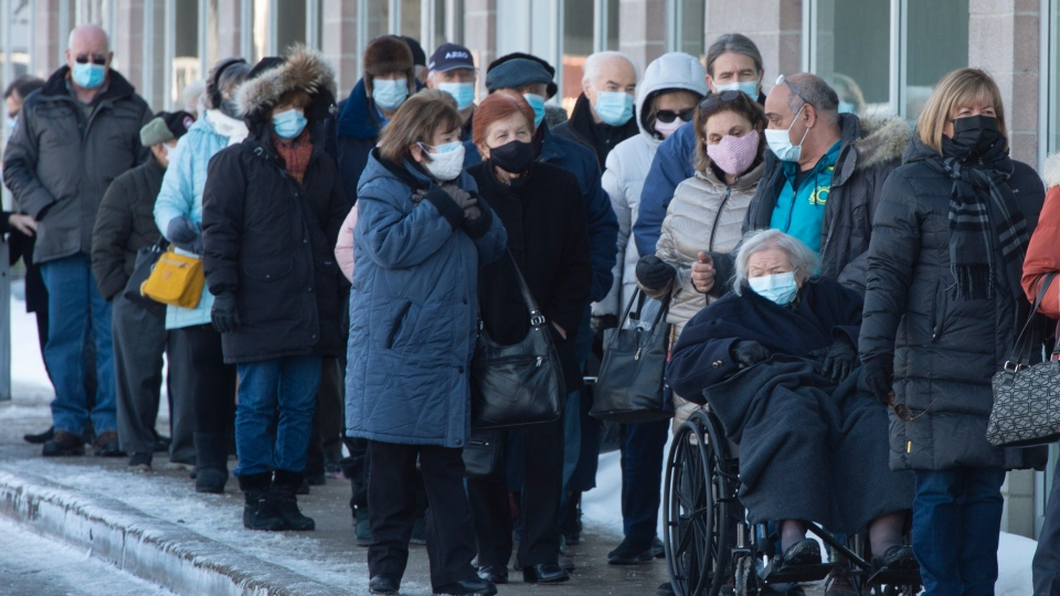 Seniors 85-years-old and over line up for their shots at a COVID-19 vaccination clinic Friday, February 26, 2021 in Laval, Quebec. Feb. 27 marks the one-year anniversary of the first case in the province. THE CANADIAN PRESS/Ryan Remiorz