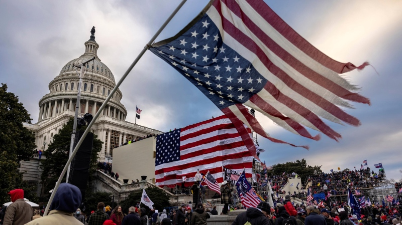 "Pro-Trump protesters gather in front of the U.S. Capitol Building on January 6 in Washington, D.C. They have said ""It was not Antifa."" (Brent Stirton/Getty Images/CNN)"