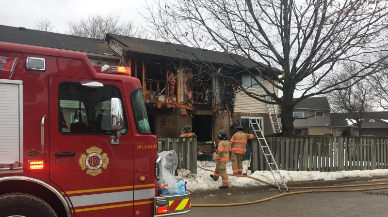 Townhouse fire investigation on Admiral Drive in London, Ont. on Feb. 27, 2021. (Brent Lale/CTV London)
