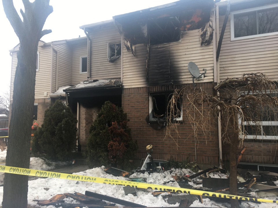 A townhouse fire investigation on Admiral Drive in London, Ont. on Feb. 27, 2021. (Brent Lale/CTV London)