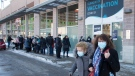 People leave a COVID-19 vaccination clinic as seniors 85 and over line up for their shots, Friday, February 26, 2021 in Laval, Que. THE CANADIAN PRESS/Ryan Remiorz