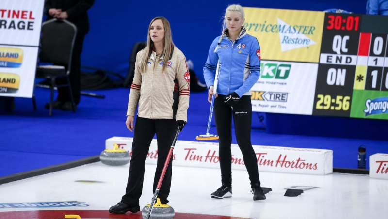 Team Ontario skip Rachel Homan, left, directs her team as Team Quebec skip Laurie St-Georges looks on at the Scotties Tournament of Hearts in Calgary, Alta., Friday, Feb. 26, 2021.THE CANADIAN PRESS/Jeff McIntosh