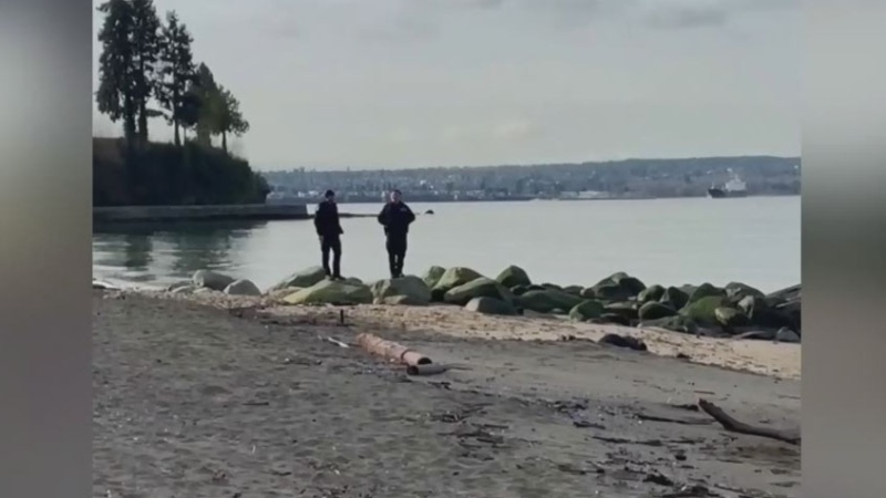 Officers seen posing in front of body