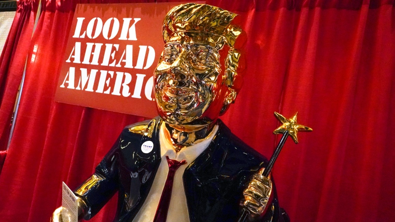 A statue of former U.S. President Donald Trump on display at the merchandise show at the Conservative Political Action Conference (CPAC) Friday, Feb. 26, 2021, in Orlando, Fla. (AP Photo/John Raoux)
