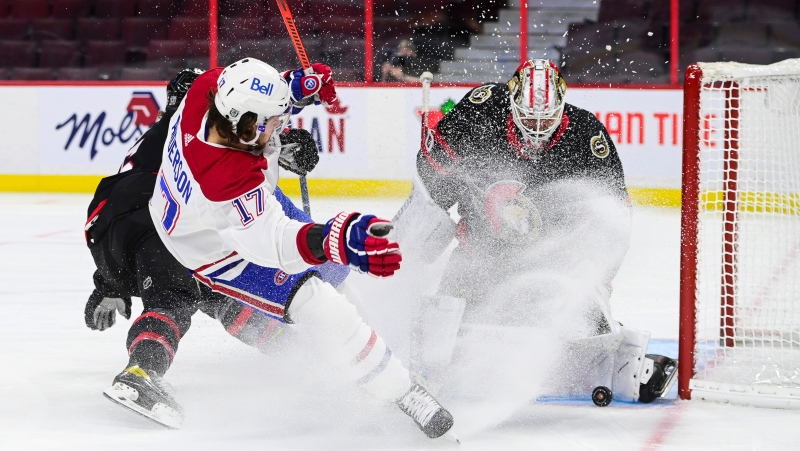 Ottawa Senators goaltender Matt Murray (30) stops a shot from Montreal Canadiens right wing Josh Anderson (17) as Senators defenceman Mike Reilly (5) defends during first period NHL action in Ottawa on Tuesday, Feb. 23, 2021. THE CANADIAN PRESS/Sean Kilpatrick
