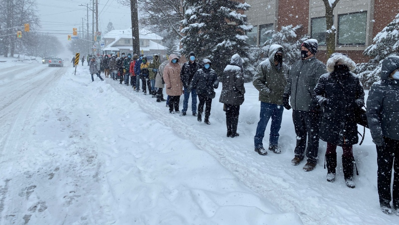 Front-line workers wait in line on a snowy Saturday for their COVID-19 vaccines. Feb. 27, 2021. (Jeremie Charron / CTV News Ottawa)