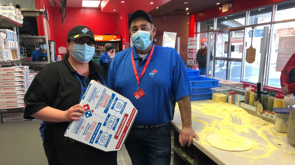 Mike Diab and Domino's general manager Brandy Vanevery during the 'Talking Over Pizza' fundraiser in in Leamington, Ont. on Saturday, Feb. 27, 2021. (Alana Hadadean/CTV Windsor)
