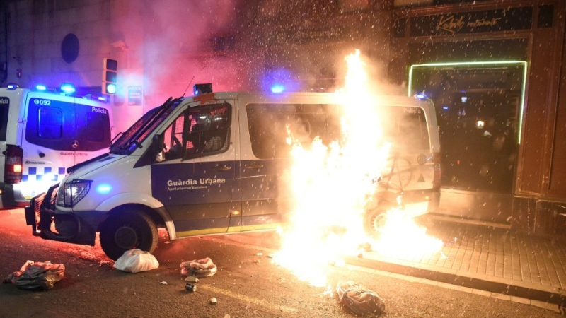 A Catalan police van is hit with a Molotov cocktail during a Barcelona protest against the controversial jailing of a rapper. (AFP)