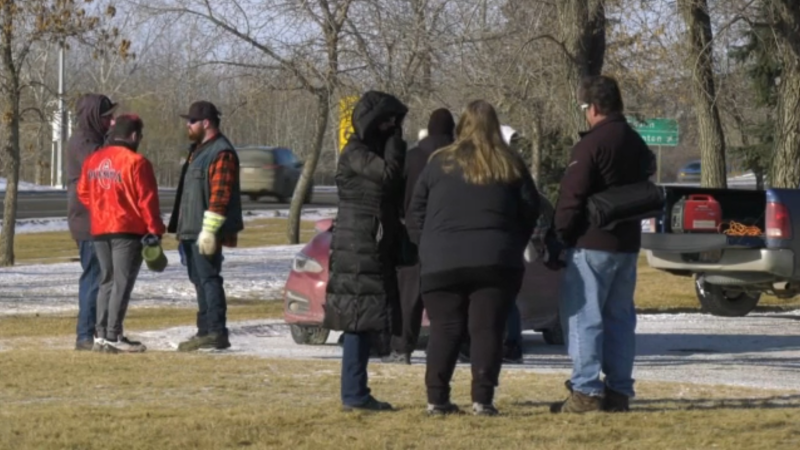 Protesters gathered outside the Stony Plain courthouse on Saturday to demand the freedom of pastor James Coates.