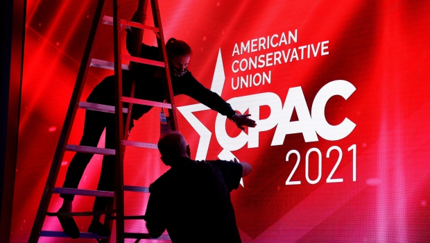 Technicians work on the stage before the start of the Conservative Political Action Conference (CPAC) in Orlando, Florida. (Joe Skipper/Reuters/CNN)