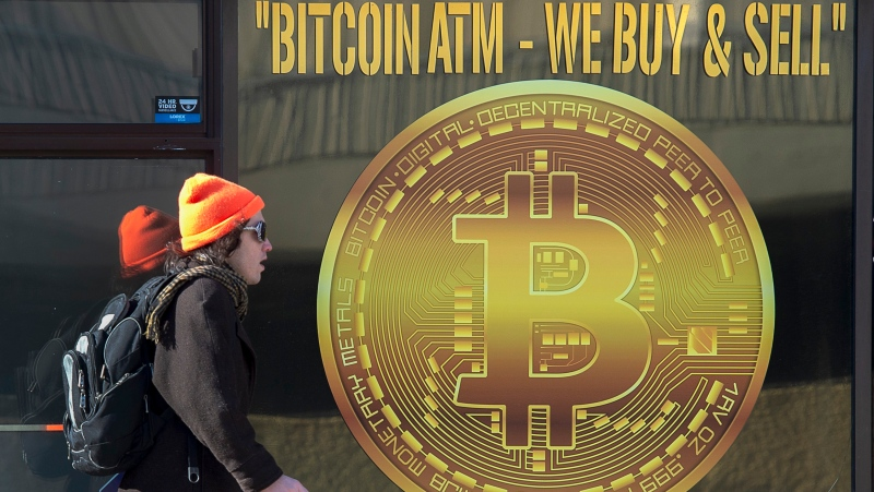 A sign advertises a Bitcoin automated teller machine, ATM, at a shop in Halifax on Wednesday, February 4, 2020. Bitcoin is a cryptocurrency which isn't controlled by a central bank or agency. Bitcoin is created, distributed, traded and stored with the use of a decentralized ledger system known as blockchain. These transactions are transparent and secure. THE CANADIAN PRESS/Andrew Vaughan