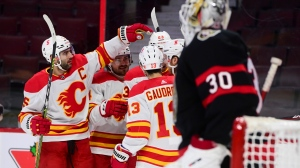 Calgary Flames captain Mark Giordano (5) and teammates congratulate Flames centre Elias Lindholm (28) on a goal against the Ottawa Senators during first period NHL action in Ottawa on Saturday, Feb. 27, 2021. THE CANADIAN PRESS/Sean Kilpatrick