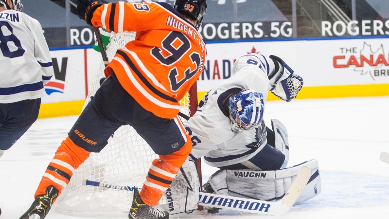 Edmonton Oilers' Ryan Nugent-Hopkins (93) is stopped by Toronto Maple Leafs goalie Jack Campbell (36) during second period NHL action in Edmonton on Saturday, February 27, 2021.THE CANADIAN PRESS/Jason Franson