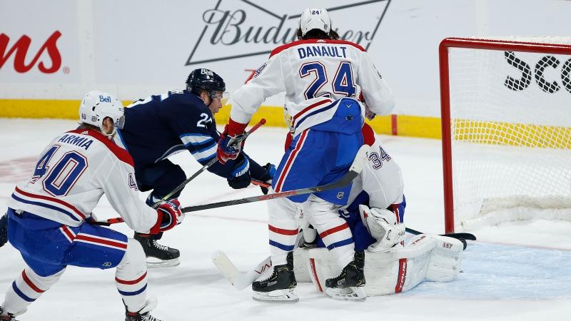 Winnipeg Jets' Paul Stastny (25) taps in the game winner past Montreal Canadiens goaltender Jake Allen (34) in overtime NHL action in Winnipeg on Saturday, February 27, 2021. THE CANADIAN PRESS/John Woods
