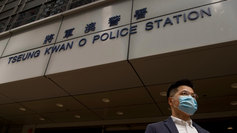 Former legislator and District Council member Gary Fan who was arrested under Hong Kong's national security law poses for photographers before walking in a police station in Hong Kong Sunday, Feb. 28, 2021. (AP Photo/Vincent Yu)