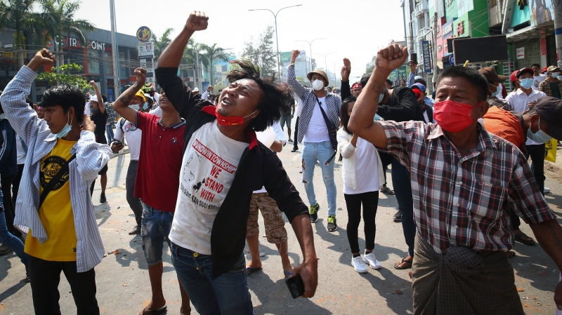 Protesters shout slogans during a protest against the military coup in Mandalay, Myanmar, Sunday, Feb. 28, 2021. (AP Photo)