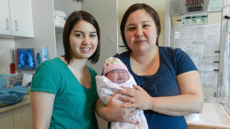 Inuit midwives Cas Augaarjuk Connelly (left) and Rachel Qiliqti Kaludjak pose after a birth at Rankin Inlet's birthing centre in 2012. (THE CANADIAN PRESS/HO-Rachel Qiliqti Kaludjak and Cas Augaarjuk Connelly)