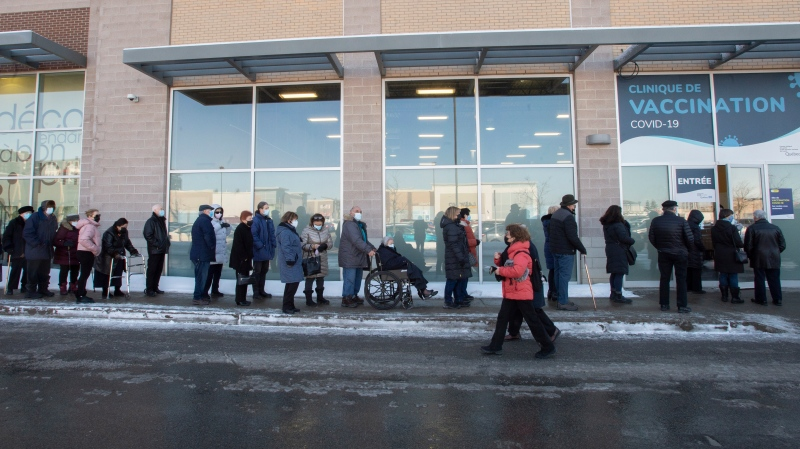 Seniors 85 and over line up for their shots at a COVID-19 vaccination clinic Friday, February 26, 2021 in Laval, Que.THE CANADIAN PRESS/Ryan Remiorz