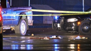 Police tape sections off an area behind the Abbotsford Recreation Centre after a double stabbing incident on Feb. 27, 2021 in Abbotsford B.C.