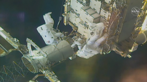 Two NASA astronauts installed support frames for new solar panels that will be installed on the International Space Station later this year.