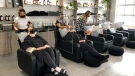Clients getting their hair washed at salon Hair by Adamo in Ottawa. (Dave Charbonneau/CTV News Ottawa)