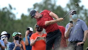 Rory McIlroy, of Northern Ireland, hits onto the seventh fairway from the rough along the third fairway during the final round of the Workday Championship golf tournament Sunday, Feb. 28, 2021, in Bradenton, Fla. (AP Photo/Phelan M. Ebenhack)