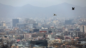 In this Feb. 1, 2021 file photo, birds flyover the city of Kabul, Afghanistan. (AP Photo/Rahmat Gul, File)