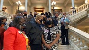 Georgia House Democrats whisper to Democratic Rep. Park Cannon, right, on Friday, Feb. 26, 2021 in Atlanta. (AP Photo/Jeff Amy)