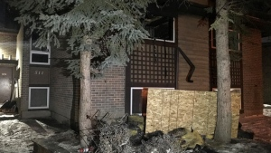 Fire crews responded to a multi-family home in Woodlands Sunday night after fire broke out in a second storey unit.