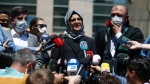 Hatice Cengiz, the fiancee of slain Saudi journalist Jamal Kashoggi, talks to members of the media outside a court in Istanbul, Friday, July 3, 2020. (AP Photo/Emrah Gurel)