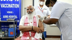 Modi received a domestic developed vaccine, Covaxin, in a carefully choreographed operation at the AIIMS national medical institute. (AFP)