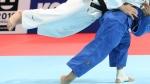 Luka Maisuradze of Georgia, top, competes against Saeid Mollaei of Iran during a men's -81 kilogram bronze medal match of the World Judo Championships in Tokyo, Wednesday, Aug. 28, 2019. (AP Photo/Koji Sasahara)