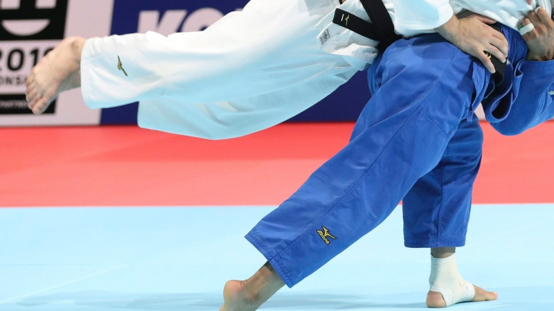 Luka Maisuradze of Georgia, top, competes against Saeid Mollaei of Iran during a men's -81 kilogram bronze medal match of the World Judo Championships in Tokyo, Wednesday, Aug. 28, 2019. (AP Photo/Koji Sasahara)