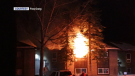 Flames pouring from a second-storey window on Woodridge Terrace S.W. Sunday night. (courtesy: Freq Gang)