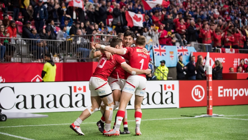 Canada's Pat Kay, from left to right, Nathan Hirayama, Theo Sauder and Harry Jones, back, celebrate Sauder's try against Spain during a quarterfinal match at the Canada Sevens rugby tournament in Vancouver, B.C., Sunday, March 8, 2020. THE CANADIAN PRESS/Darryl Dyck